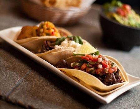 Three Canonita Tacos plated