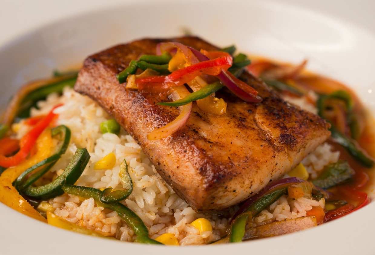 Veracruz Mahi Mahi - Fish plated over rice with vegetables